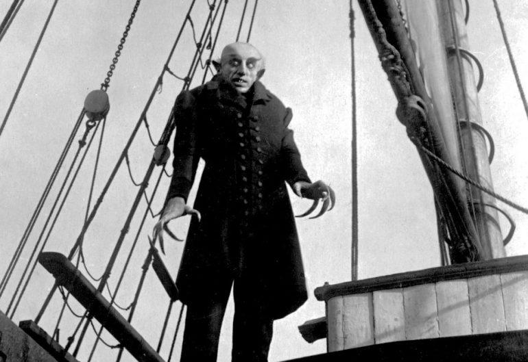 F. W. Murnau's Nosferatu (1922) starring Max Schreck was the first vampire movie and it's a legendary piece of filmmaking.